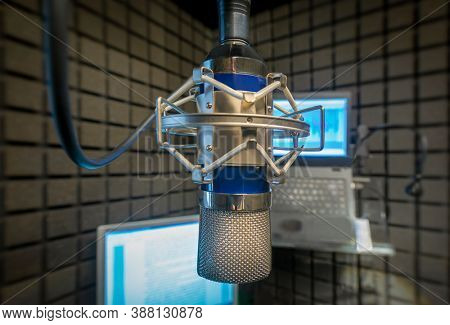 Podcast microphone and laptop computer  in recording studio