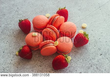 Macaroons. Delicious French Desserts. Macaroons On The Table. Macaroons With Strawberries