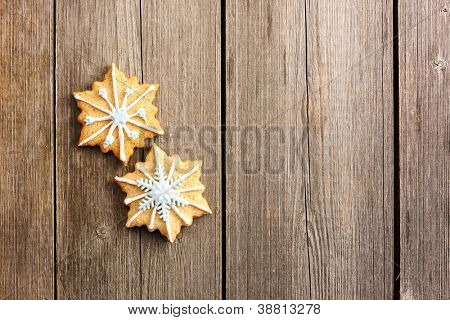 Christmas homemade gingerbread cookie over wooden table