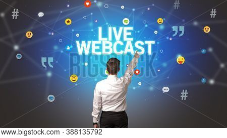 Rear view of a businessman with LIVE WEBCAST inscription, social networking concept