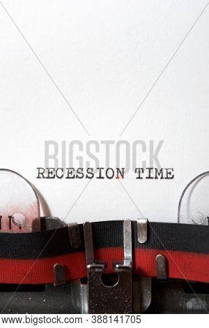 Recession time phrase written with a typewriter.