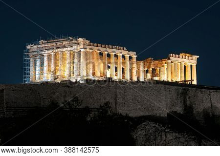 Parthenon Temple On Acropolis Hill At Night, Athens, Greece. It Is Top Landmark Of City. Beautiful I