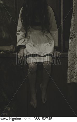 Demon Possessed Little Girl At Night. Mad Scary Girl At Dark Night. Horror Background With Child Pos