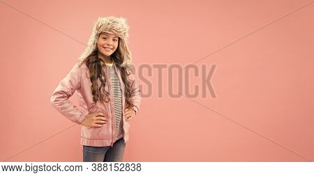 Winter Fashion Concept. Warm Hat For Cold Weather. Faux Fur Trend. Playful Kid Girl Wear Fur Hat Wit