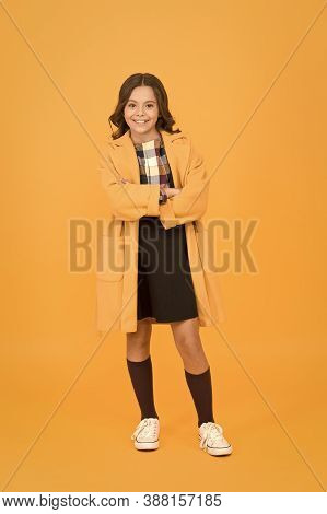 Get Cozy In Style This Autumn Season. Happy Small Girl Wear Comfortable Fashion Style. Little Child