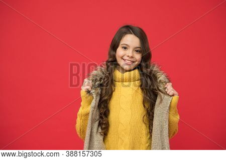 Kid Autumn Fashion Style. Happy Child Wear Knitted Sweater And Waistcoat. Teen Girl Has Long Curly H