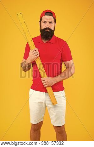 What About Your Size. Bearded Man With Big Measuring Instrument. Measuring With Ruler. Size Measurem