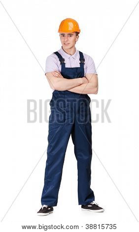 Full length portrait of foreman in overalls and orange hard hat, isolated on white