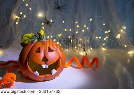 Pumpkin Head And Garlands. Halloween Pumpkin Head Jack Lantern With Burning Candles. Halloween Holid