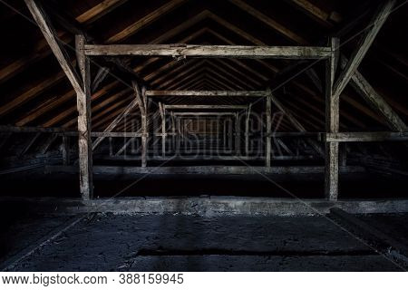 Picture Of An Old Dark And Abandoned Attic Of A Residential Building With A Focus On The Decaying Fr