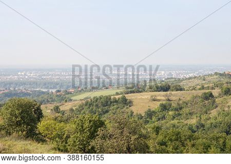 Aerial Panoramal Of Novi Sad, Seen From A Hill Of Fruska Gora National Park During A Summer Afternoo