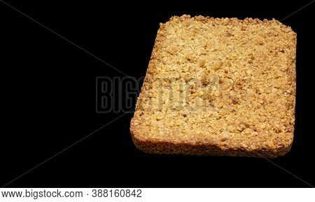 Top-down View Of Home-made Flapjack Isolated On A Black Background