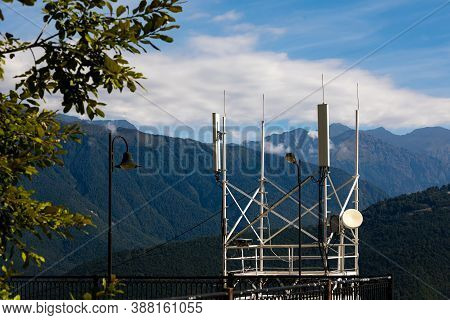 Telecommunications Transmitters 4g, 5g. Cellular Base Station With Transmitter Antennas On The Backg