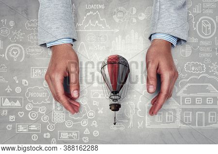 Hands and hot air baloon