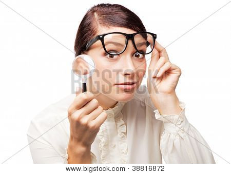 Woman holding a magnifying glass, white background