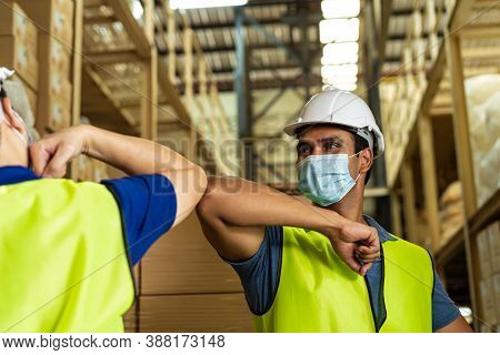 Indian Male Factory Warehouse Worker Wearing Face Mask Working In Logistic Industry Indoor. Friends
