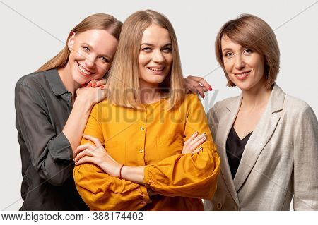 Female Friendship. Trust Support. Positive Attitude. Three Confident Cheerful Mature Women Standing