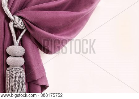 Draped Curtains Against A White Wall. The Fabric Is Tied With A Decorative Cord With A Brush. Copy S