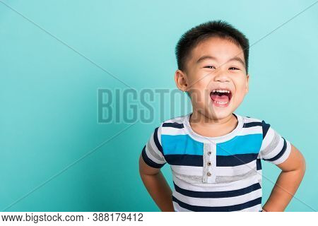 Asian Portrait Of Cute Little Boy Kid Happy Face He Laughing Smiles And Looking To Camera, Studio Sh