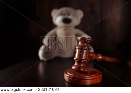 Divorce And Separation Concept. Wooden Gavel And Teddy Bear As A Symbol Children Protection