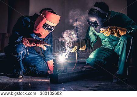 Metal Welding Steel Works Using Electric Arc Welding Machine To Weld Steel At Factory. Metalwork Man