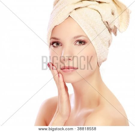 A beautiful woman with a towel on her head, isolated on white