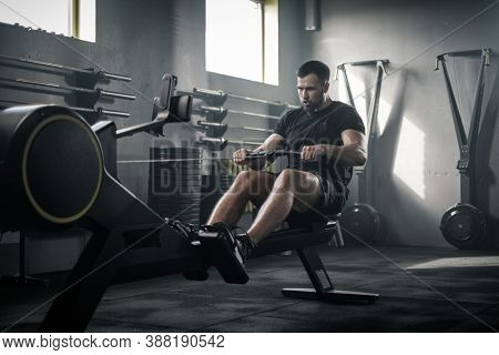 Serious Strong Male Finish Training With Rowing Machine .