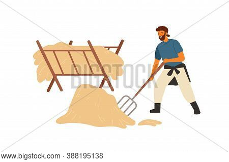 Happy Farmer, Peasant Or Rancher Man Working With Pitchfork Near Manger Full Of Hay. Agricultural Wo