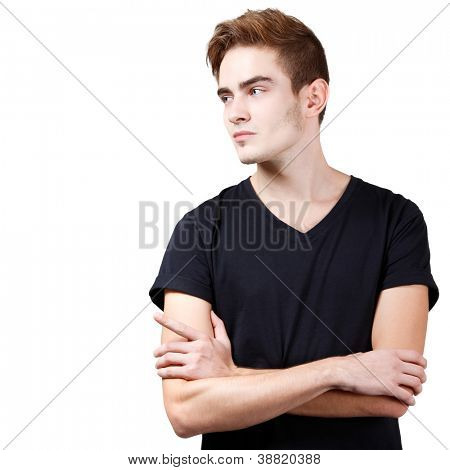 Handsome young man pointing at copyspace with his hand, portrait of sexy guy looking right over white background