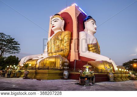 Four Faces of Buddha or Kyaikpun Buddha in Bago is a famous shrine of four sitting statues in Myanmar from 15th century. Evening photo