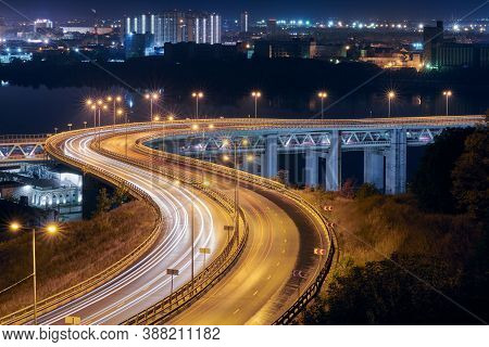 Highway At Night Lights. Fast Car Light Path, Trails And Streaks On Interchange Bridge Road. Night L