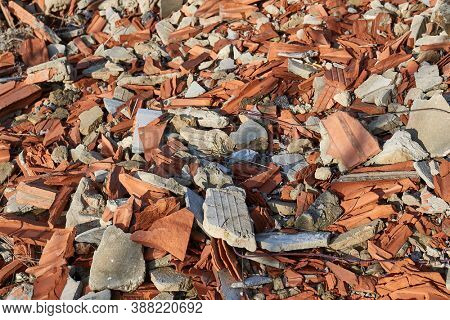 Pile of debris of a destroyed building, mostly roof tiles and bricks