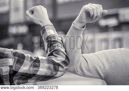 Friends Shaking Elbows Outdoors. Elbow Greeting Style. Coronavirus Epidemic. Dont Shake Hands. Stop