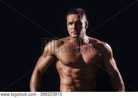 Portrait Of Strong Healthy Handsome Athletic Man. Strong Athletic Man Showing Muscular Body And Sixp
