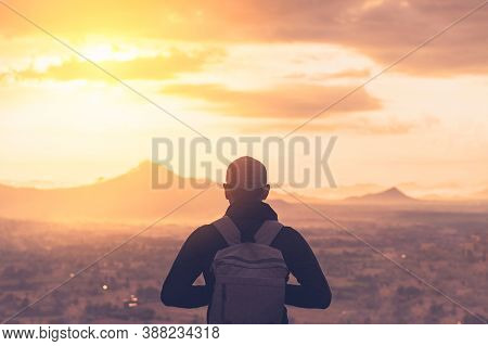 Backpacker Man Standing At Top Of Mountain Looking View Landscape With Sunset Sky White Cloud Abstra