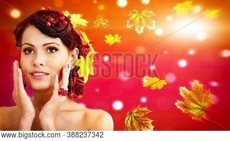 Autumn banners leaves background with beauty face and hands of beautiful woman. Fashion dream in red fall color outside.
