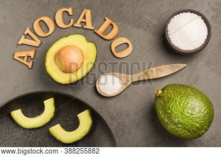Persea Americana - Avocado With Sea Salt. Title In Wooden Letters