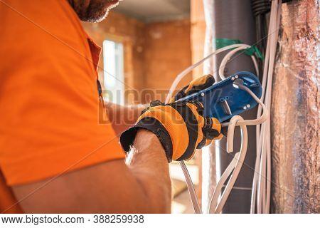 Caucasian Electrician In His 40s Preparing Electric Outlet Inside Concrete Bricks Commercial Buildin