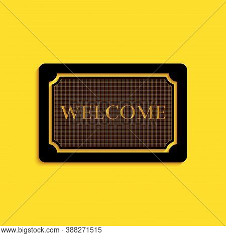 Black Doormat With The Text Welcome Icon Isolated On Yellow Background. Welcome Mat Sign. Long Shado