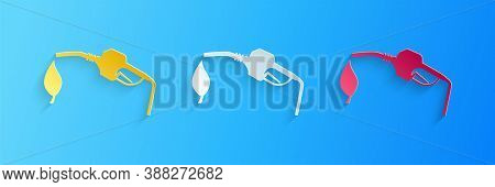 Paper Cut Bio Fuel Concept With Fueling Nozzle And Leaf Icon Isolated On Blue Background. Natural En