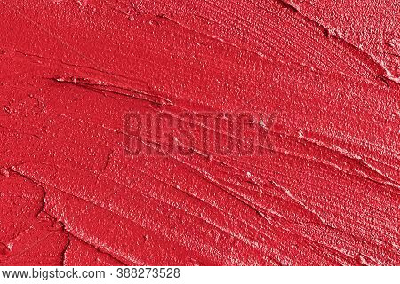Creamy Red Lipstick In Liquid Form, Textural Strokes, Macro Background. Concept Of Trends In Cosmeti