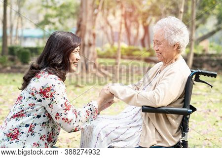 Asian Senior Or Elderly Old Lady Woman Patient With Care, Help And Support On Wheelchair In Park In
