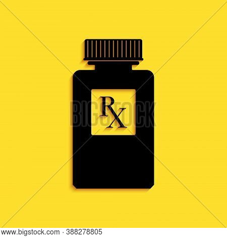 Black Pill Bottle With Rx Sign And Pills Icon Isolated On Yellow Background. Pharmacy Design. Rx As