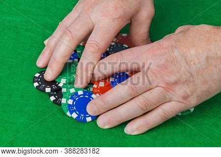 Hands and casino chips - gambling background