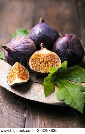 Figs. Fresh Fig. Ripe Fig Fruits With Fig Leaves On The Wooden Background