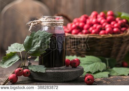 Hawthorn Berries  Tincture Or Infusion Bottle And Basket Of Thorn Apples On Wooden Board. Herbal Med