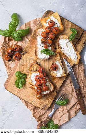 Tasty Tapas, Snack Or Crostini Or Bruschetta With Toasted Baguette, Roasted Tomatoes. Delicious Brea