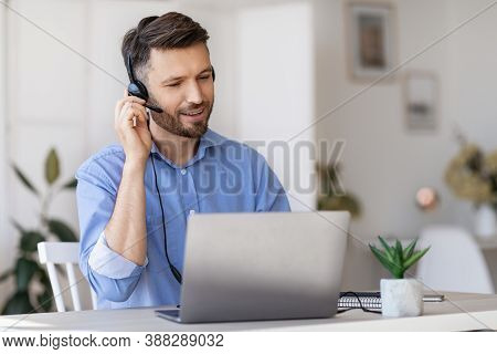 Hotline Operator. Portrait Of Handsome Male Call-center Employee Wearing Headset At Workplace In Off