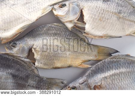 Dry River Fish On White Background. Salty Beer Appetizer. Dried Carp With Salt.