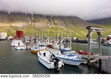 Isafjordur, Iceland - July 7, 2014: The Harbour Of The Isafjordur City In Iceland With A Small Gate,